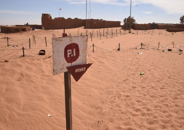 A picture taken in Madama near the border with Lybia on January 1, 2015 shows a board warning against landmines.