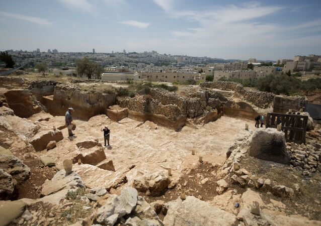 Israeli Antiquities Authority archaeologists work at the excavation site of a 2,000-year-old stone quarry dating back to the Second Temple period discovered in Jerusalem on May 8, 2013 before the construction of a new road in the northern part of city.