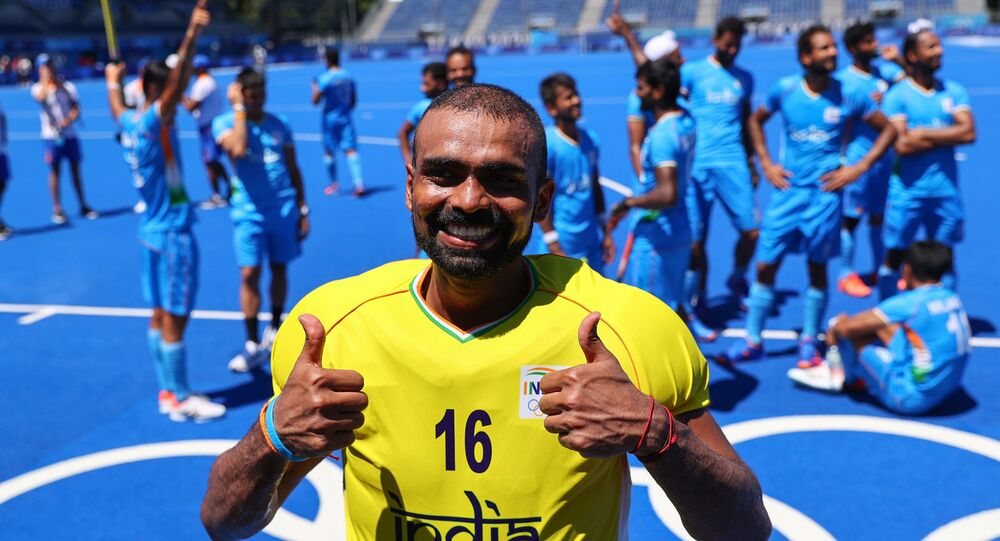 Tokyo 2020 Olympics - Hockey - Men - Bronze medal match - Germany v India - Oi Hockey Stadium, Tokyo, Japan - August 5, 2021. Sreejesh Parattu Raveendran of India poses for pictures as he celebrates winning the match for bronze.