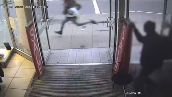 Sudesh Amman, armed with a knife, is seen running along Streatham High Road shortly before being shot by police - Sputnik International