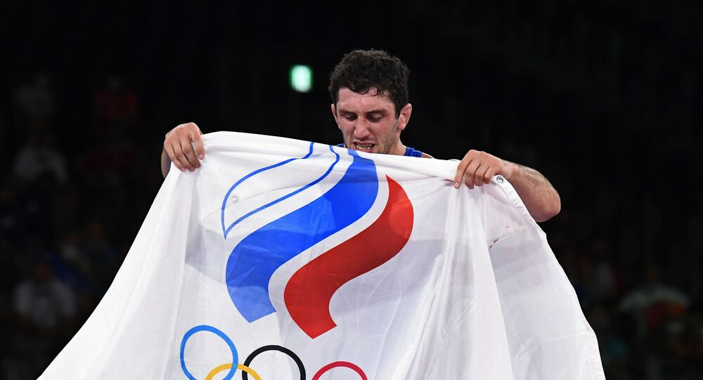 Tokyo 2020 Olympics - Wrestling - Freestyle - Men's 74kg Makuhari Messe Hall A, Chiba, Japan - August 6, 2021. Zaurbek Sidakov of the Russian Olympic Committee celebrates after winning gold.