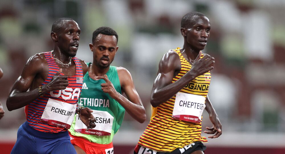 Tokyo 2020 Olympics - Athletics - Men's 5000m - Final - Olympic Stadium, Tokyo, Japan - August 6, 2021. Joshua Cheptegei of Uganda, Paul Chelimo of the United States, and Milkesa Mengesha of Ethiopia during the race.