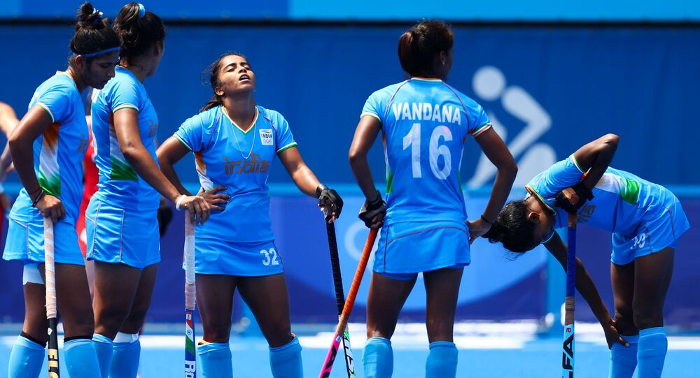 Members of the Indian team wait for the referee's decision on a video referral.