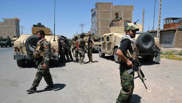 In this picture, taken on 1 August 2021, Afghan National Army commando forces walk along a road amid ongoing fighting between Taliban and Afghan security forces in the Enjil district of Herat province - Sputnik International