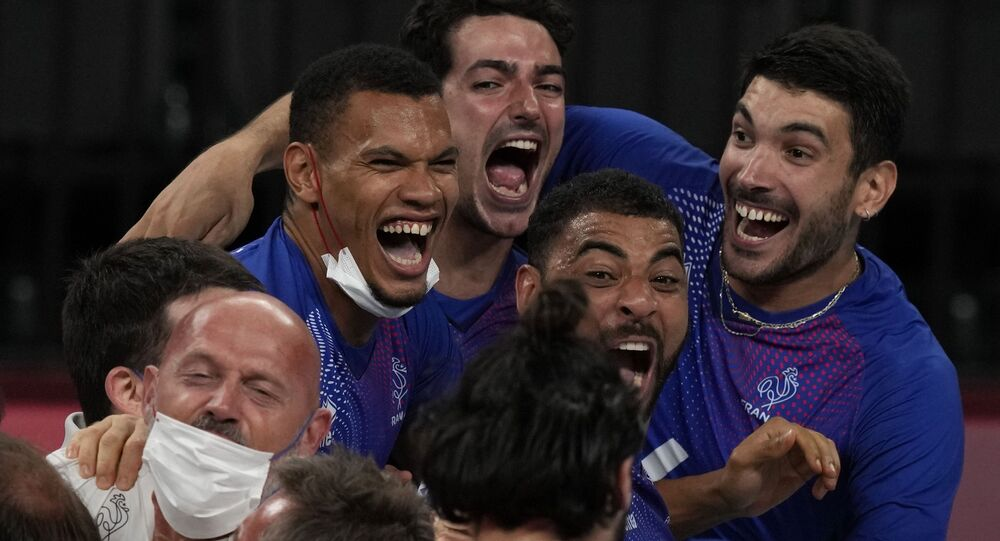 Team France celebrates winning the men's volleyball gold medal match against the Russian Olympic Committee, at the 2020 Summer Olympics