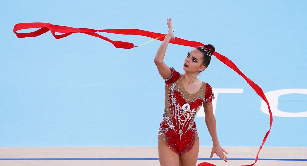 Russian Olympic Committee's Dina Averina performs with the ribbon in the rhythmic gymnastics individual all-around final at the Tokyo 2020 Olympic Games at Ariake Gymnastics Centre in Tokyo, Japan.