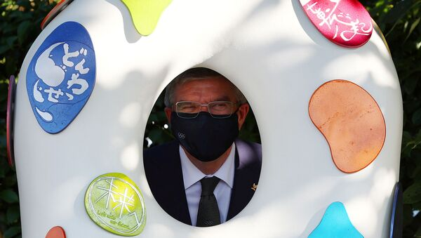 International Olympic Committee (IOC) President Thomas Bach poses with a Tokyo 2020 recovery monument as he visits the monuments next to the National Stadium, the main stadium of Tokyo 2020 Olympic and Paralympic Games, in Tokyo , Japan, August 1, 2021. - Sputnik International