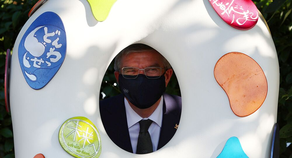 International Olympic Committee (IOC) President Thomas Bach poses with a Tokyo 2020 recovery monument as he visits the monuments next to the National Stadium, the main stadium of Tokyo 2020 Olympic and Paralympic Games, in Tokyo , Japan, August 1, 2021.