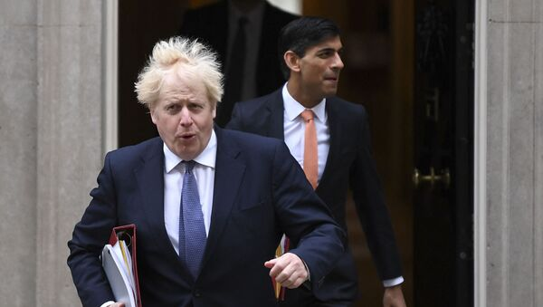 Britain's Prime Minister Boris Johnson (L) and Britain's Chancellor of the Exchequer Rishi Sunak (R) leave 10 Downing Street to attend the weekly cabinet meeting in London on October 13, 2020 held at the Foreign, Commonwealth and Development Office - Sputnik International