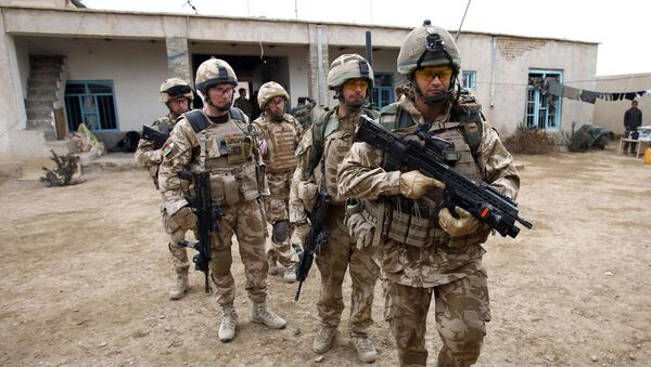 British soldier Lieutenant-Colonel Nick Lock (2L) gathers his soldiers of the 1st Batallion of the Royal Welsh before a patrol in the streets of Showal in Nad-e-Ali district, Southern Afghanistan, in Helmand Province on February 25, 2010 - Sputnik International