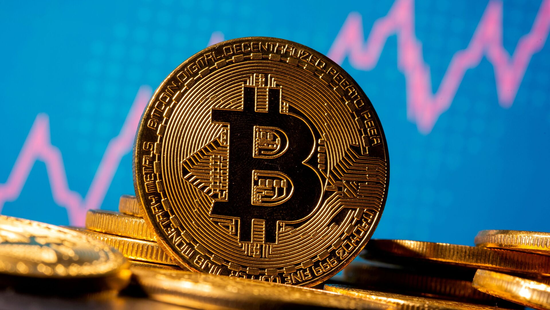 FILE PHOTO: A representation of virtual currency bitcoin is seen in front of a stock graph in this illustration taken November 19, 2020. REUTERS/Dado Ruvic/Illustration/File Photo - Sputnik International, 1920, 06.09.2021
