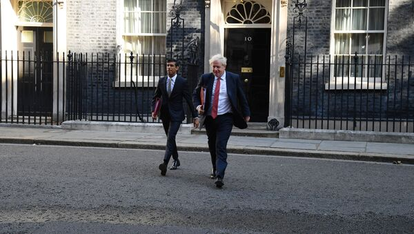 Britain's Prime Minister Boris Johnson (R) and Britain's Chancellor of the Exchequer Rishi Sunak (L) leave 10 Downing Street in central London on September 1, 2020 to walk through to the Foreign and Commonwealth Office to attend the first weekly meeting of the cabinet since the summer recess.  - Sputnik International
