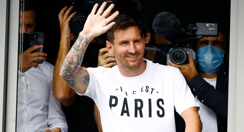 Argentine football player Lionel Messi, waves to supporters after landing on 10 August 2021 at Le Bourget airport, north of Paris, to join as Paris Saint-Germain's newest player.