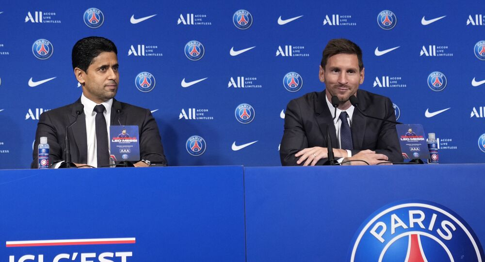 Lionel Messi, right, and PSG president Nasser Al-Al-Khelaifi attend a press conference Wednesday, Aug. 11, 2021 at the Parc des Princes stadium in Paris.