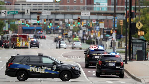 Baltimore City police vehicles block off Pratt Street near the Transamerica Building as officials are investigating a suspicious van in a parking garage on September 09, 2019 in Baltimore, Maryland. - Sputnik International
