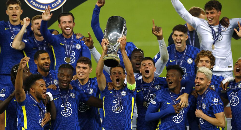 Soccer Football - European Super Cup - Chelsea v Villarreal - Windsor Park, Belfast, Northern Ireland - August 11, 2021 Chelsea's Cesar Azpilicueta and teammates celebrate with the trophy after winning the penalty shoot-out and the European Super Cup