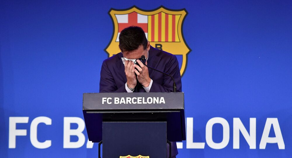 Barcelona's Argentinian forward Lionel Messi cries during a press conference at the Camp Nou stadium in Barcelona on August 8, 2021.