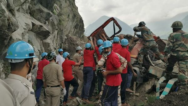 Indo-Tibetan Border Police (ITBP) personnel remove a damaged truck during a rescue operation at the site of a landslide in Kinnaur district in the northern state of Himachal Pradesh, India, August 11, 2021 - Sputnik International