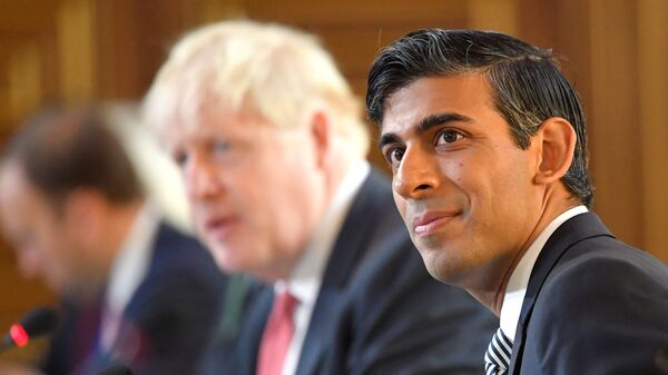 Britain's Chancellor of the Exchequer Rishi Sunak (R) sits beside Britain's Prime Minister Boris Johnson (C) at a Cabinet meeting of senior government ministers at the Foreign and Commonwealth Office (FCO) in London on September 1, 2020.  - Sputnik International