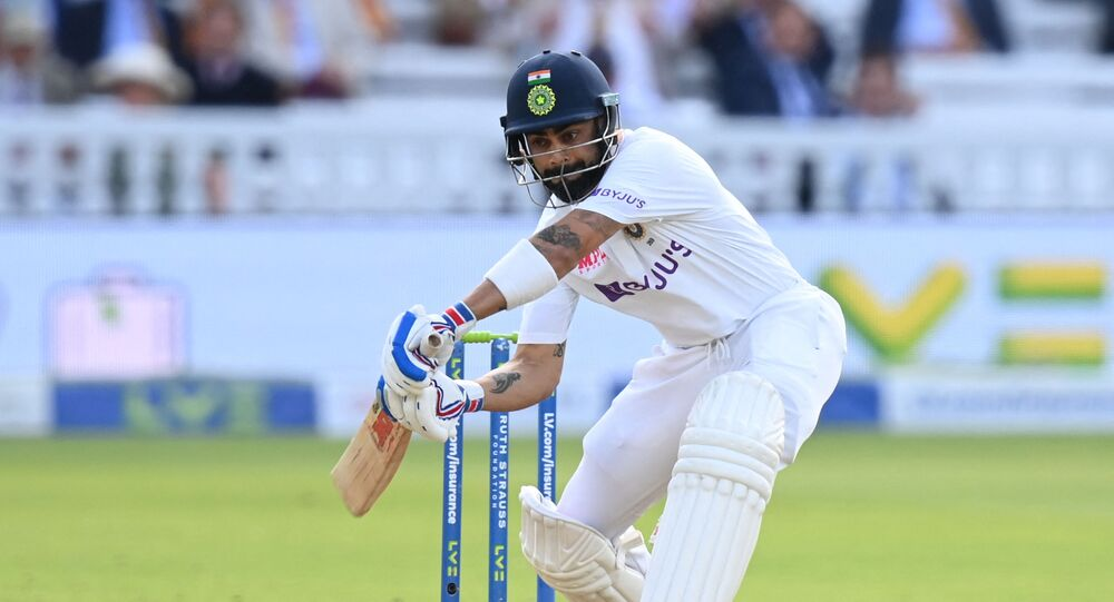 India's captain Virat Kohli plays a shot on the first day of the second cricket Test match between England and India at Lord's cricket ground in London on August 12, 2021.