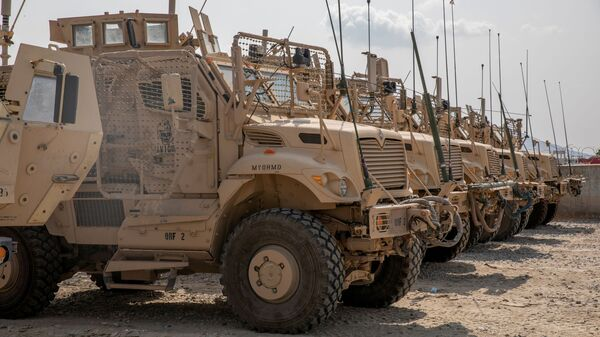 U.S. Army soldiers from the 10th Mountain Division and U.S. contractors prepare Mine Resistant Ambush Protected vehicles, MRAPs, to be transported off of base in support of the withdrawal mission in Kandahar, Afghanistan, August 21, 2020. Picture taken August 21, 2020. U.S. Army/Sgt. Jeffery J. Harris - Sputnik International