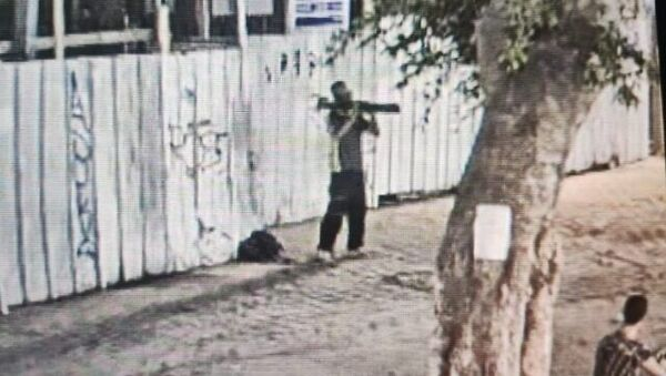 A homeless man is seen pointing a M72 LAW toward a store in Tel Aviv, August 14, 2021.  - Sputnik International