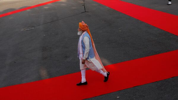 Indian Prime Minister Narendra Modi walks after inspecting the honour guard during Independence Day celebrations at the historic Red Fort in Delhi, India, August 15, 2021.  - Sputnik International