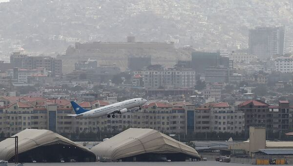 This picture taken on August 14, 2021 shows an Ariana Afghan Airlines aircraft taking-off from the airport in Kabul. - Sputnik International