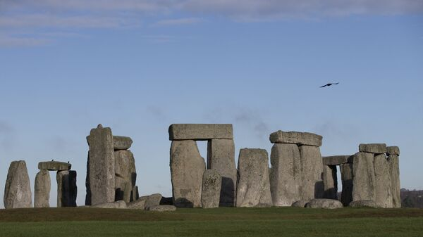In this Tuesday, Dec. 17, 2013 file photo, visitors take photographs of the world heritage site of Stonehenge, England.  - Sputnik International