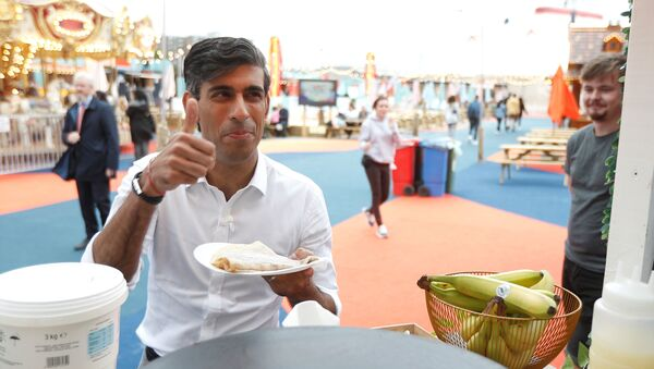 Britain's Chancellor Rishi Sunak takes a pancake from a stall at the London Wonderground comedy and music festival venue in London - Sputnik International