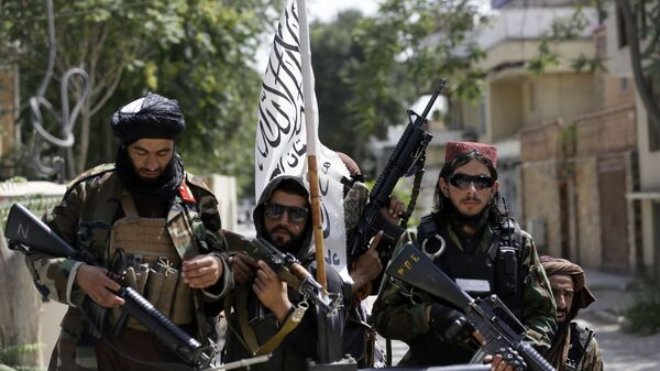 In this Aug. 19, 2021 file photo, Taliban fighters display their flag on patrol in Kabul, Afghanistan. When U.S. President Joe Biden took office early this year, Western allies were falling over themselves to welcome and praise him and hail a new era in trans-Atlantic cooperation. - Sputnik International