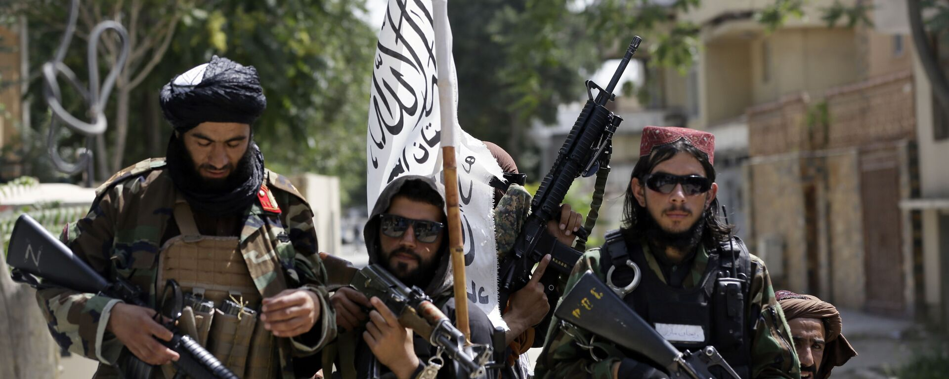 In this Aug. 19, 2021 file photo, Taliban fighters display their flag on patrol in Kabul, Afghanistan. When U.S. President Joe Biden took office early this year, Western allies were falling over themselves to welcome and praise him and hail a new era in trans-Atlantic cooperation. - Sputnik International, 1920, 25.08.2021