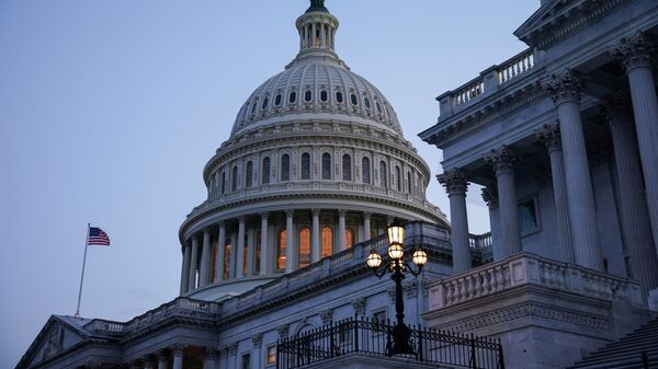 FILE PHOTO: The exterior of the U.S. Capitol is seen as Senators work to advance the bipartisan infrastructure bill in Washington, U.S., August 8, 2021. REUTERS/Sarah Silbiger/File Photo - Sputnik International