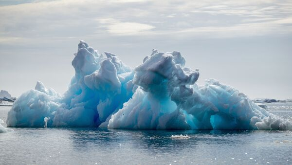 FILE PHOTO: An iceberg floats in a fjord near Tasiilaq, Greenland, June 16, 2018.  - Sputnik International