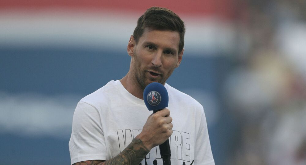 Paris Saint-Germain's Argentinian forward Lionel Messi speaks to the crowd as he is introduced during a presentation ceremony prior to the French L1 football match between Paris Saint-Germain and Racing Club Strasbourg at the Parc des Princes stadium in Paris on August 14, 2021.