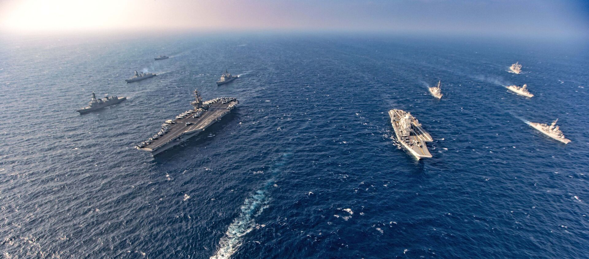 Aircraft carriers and warships participate in the second phase of Malabar naval exercise, a joint exercise comprising of India, US, Japan and Australia, in the Northern Arabian Sea on Tuesday, Nov. 17, 2020. - Sputnik International, 1920, 26.08.2021
