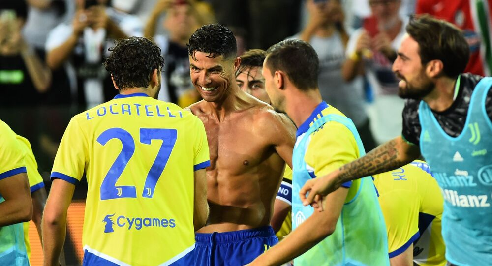 Soccer Football - Italy - Serie A - Udinese v Juventus - Dacia Arena, Udine, Italy - August 22, 2021 Juventus' Cristiano Ronaldo celebrates with teammates after scoring a goal that was later disallowed after a VAR review