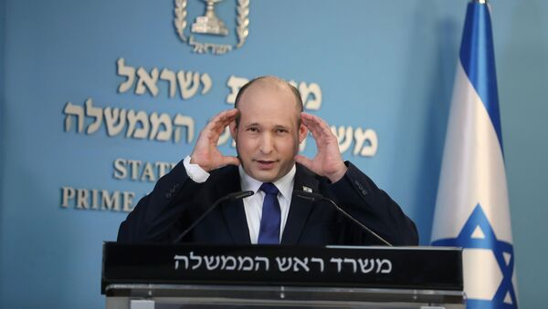 Israeli Prime Minister Naftali Bennett makes a media statement for the COVID-19 pandemic status, at the Prime minister's office in Jerusalem, August 18, 2021. - Sputnik International
