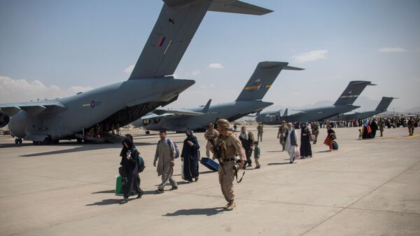 Members of the UK Armed Forces continue to take part in the evacuation of entitled personnel from Kabul airport, in Kabul, Afghanistan August 19-22, 2021, in this handout picture obtained by Reuters on August 23, 2021. LPhot Ben Shread/UK MOD Crown copyright 2021/Handout via REUTERS  THIS IMAGE HAS BEEN SUPPLIED BY A THIRD PARTY. MANDATORY CREDIT. NO RESALES. NO ARCHIVES. - Sputnik International