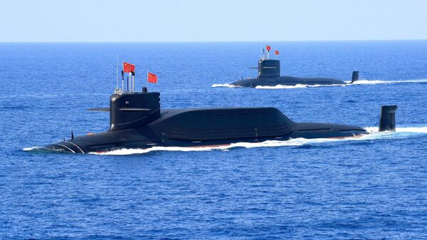 A nuclear-powered Type 094A Jin-class ballistic missile submarine of the Chinese People's Liberation Army (PLA) Navy is seen during a military display in the South China Sea April 12, 2018 - Sputnik International