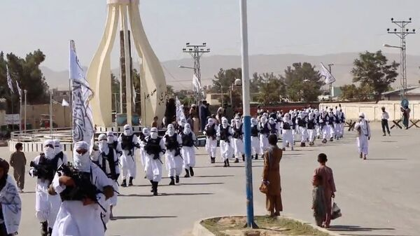 Taliban fighters march in uniforms on the street in Qalat, Zabul Province, Afghanistan, in this still image taken from social media video uploaded August 19, 2021 and obtained by REUTERS - Sputnik International