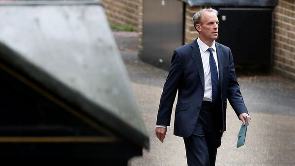 Britain's Foreign Secretary Raab walks outside the Foreign, Commonwealth and Development Office in London - Sputnik International