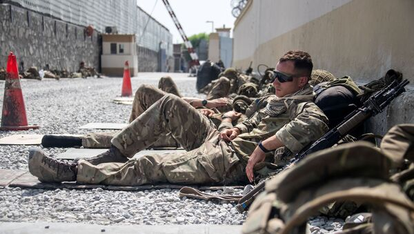 Members of the UK Armed Forces rest as they continue to take part in the evacuation of entitled personnel from Kabul airport, in Kabul, Afghanistan August 19-22, 2021, in this handout picture obtained by Reuters on August 23, 2021 - Sputnik International
