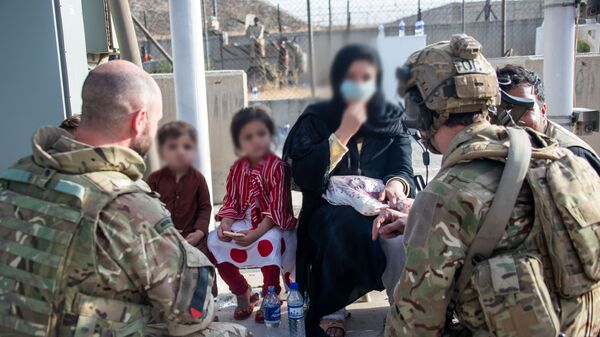 Members of the UK Armed Forces who continue to take part in the evacuation of entitled personnel from Kabul airport, in Kabul, Afghanistan August 19-22, 2021 - Sputnik International