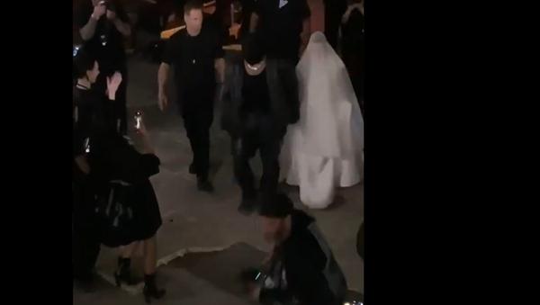 Screenshot from a video showing Kanye West and Kim Kardashian walking together after the Donda listening event - Sputnik International
