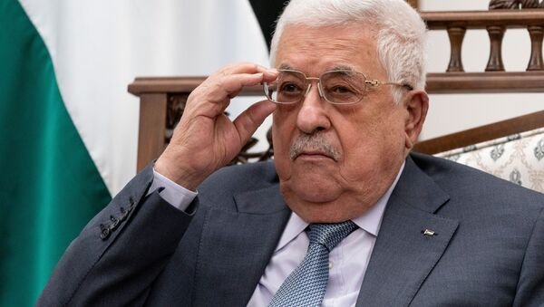 Palestinian President Mahmoud Abbas adjusts his glasses as he listens during a joint press conference with U.S. Secretary of State Antony Blinken (not pictured), in the West Bank city of Ramallah, May 25, 2021. - Sputnik International
