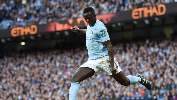 (FILES) In this file photo taken on April 22, 2018 Manchester City's French defender Benjamin Mendy crosses the ball during the English Premier League football match between Manchester City and Swansea at the Etihad Stadium in Manchester, north west England, on April 22, 2018 - Sputnik International