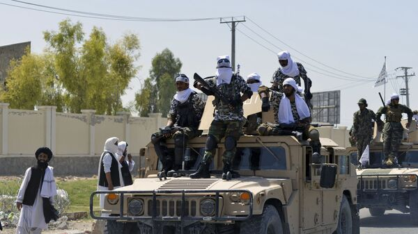 Taliban fighters atop Humvee vehicles parade along a road to celebrate after the US pulled all its troops out of Afghanistan, in Kandahar on September 1, 2021 following the Taliban's military takeover of the country - Sputnik International