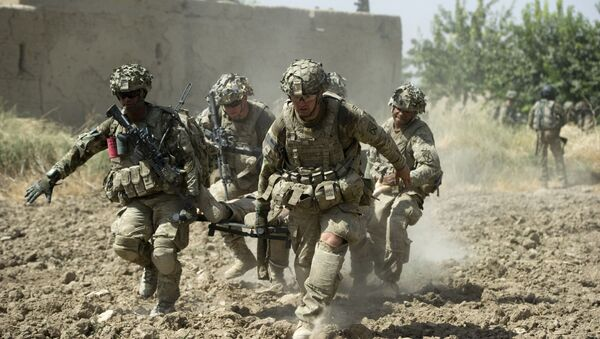 A fatally wounded US soldier is carried by comrades during fighting in Afghanistan in August 2011.  - Sputnik International