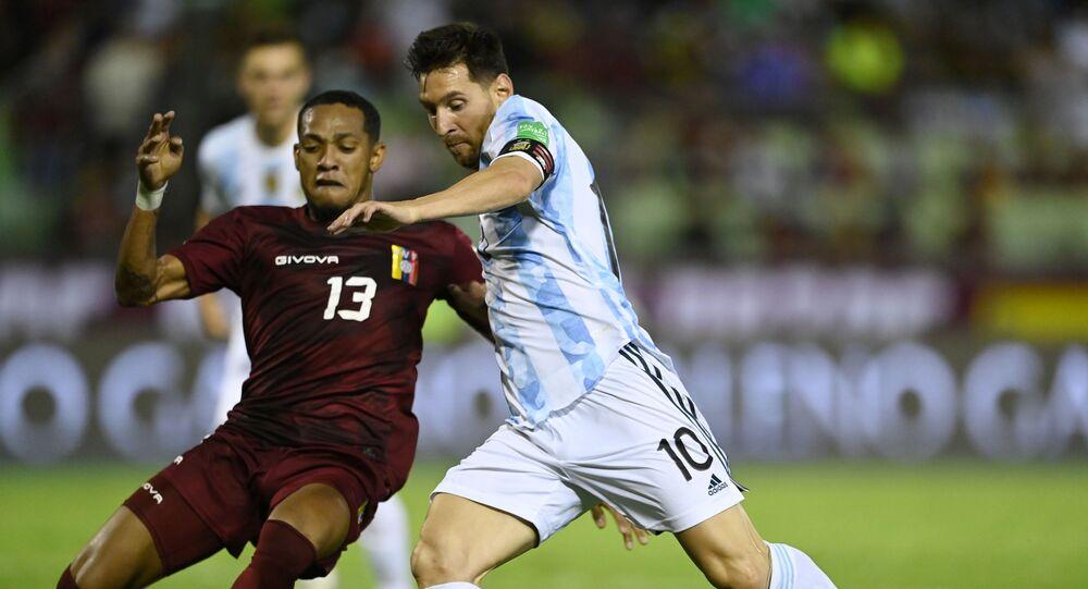 Argentina's Lionel Messi in action with Venezuela's Jose Martinez Pool